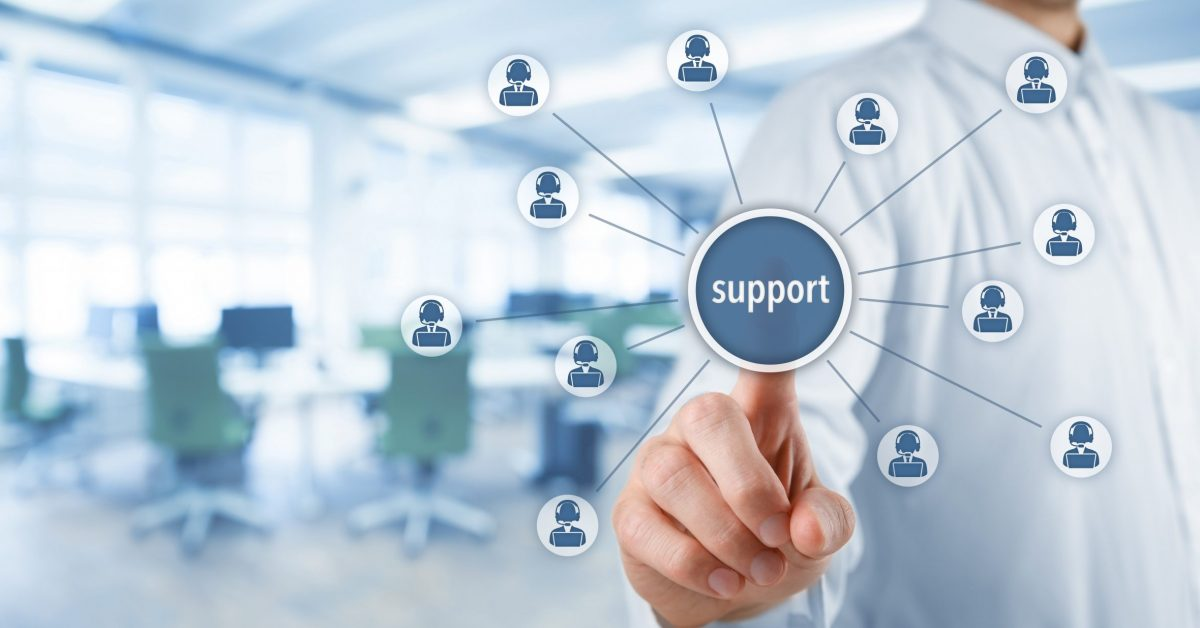 Customer care support and client service concept. Businessman click on virtual scheme representing helping customer support. Wide banner composition with office in background.